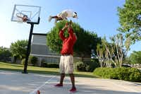Charles Davis plays with his son Chas, 3, on the basketball court near their apartment complex on the southeast corner of the Dallas North Tollway and the President George Bush Turpike. The area ranks No. 1 for urban sophisticates in Plano, Murphy and Wylie.