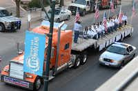 """A flatbed truck carries wounded veterans and their families during a parade before it was struck by a train Thursday, Nov. 15, 2012 in Midland, Texas. """"Show of Support"""" president and founder Terry Johnson says there are """"multiple injuries"""" after a Union Pacific train slammed into the trailer, killing at least four people and injuring 17 others. (AP Photo/Reporter-Telegram, James Durbin)James Durbin - AP"""