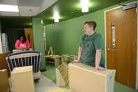 Early childhood development educators Olivia Ballard  (left) and Jennifer Smith discuss where to move furniture in a classroom at Vogel Alcove's new facility, the City Park Elementary building.Rose Baca - neighborsgo staff photographer
