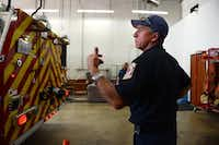 Craig Merritt directs a driver as he backs a fire engine into the station. The Rockwall Fire Department relies on Merritt and others to meet the needs not fulfilled by its handful of full-time staffers.Photo by ROSE BACA  - neighborsgo staff photographer