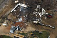 Smoke rises from a neighborhood following Wednesday's explosion in West, Texas, Thursday, April 18, 2013.G.J. McCarthy