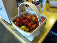 This Dec. 12, 2013 photo shows Carolina Reaper peppers at Ed Currie's store in Fort Mill, S.C. Last month, the Guinness Book of World Records decided Curries peppers were the hottest on Earth, ending a more than four-year drive to prove no one grows a more scorching chili. (AP Photo/Jeffrey Collins)Jeffrey Collins - AP