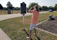 Barbara Ballard Turner of Plano takes a phone picture of a new Texas historical marker at the Wylie Cemetery in Wylie on Aug. 31. Turner said she was an ancestor of Col. W.D. Wylie, the city of Wylie's namesake and Santa Fe Railroad official and Civil War veteran.