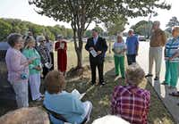 Wylie Mayor Eric Hogue (center) speaks to the crowd gathered for the unveiling of a Texas historical marker at the Wylie Cemetery. The marker is the sixth marker for the city and took about 10 years for the Wylie Cemetery Association to secure.
