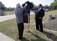 Wylie Mayor Eric Hogue (right) and Rev. Al Draper unveil a Texas historical marker at the Wylie Cemetery in Wylie on Aug. 31.