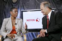 Xerox CEO Ursula Burns joined Lynn Blodgett, CEO of Affiliated Computer Services, when the deal was announced in 2009 for Xerox to acquire ACS.