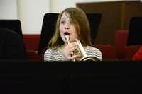 Band student Hannah Burn, 9, reacts to music instruction during the Salvation Army's Dallas Temple Community Center's free weekly band practice.Rose Baca - neighborsgo staff photographer