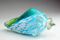 Mouth-blown glass conch shells by Raymond Rains are each unique.