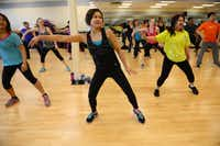 Angela Kelly participates in a Zumba class led by Tammy Elliott at Texas Family Fitness in Frisco.Rose Baca - neighborsgo staff photographer