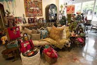 Graffiti art and funky furniture form the ideal setting for displaying Consuela's bags, pillows and other creations.