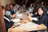 Ophelia Camina (far right) talked with Patricia Nolan (far left) during a recent Act III gathering at Olivella's.