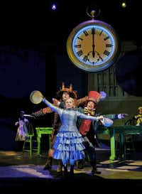 Ashley Emerson as Alice, Aubrey Allicock as the Mad Hatter, and David Trudgen as the March Hare star  in Opera Theatre of Saint Louis's 2012 production of Alice in Wonderland.