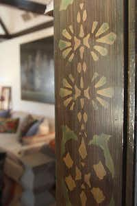The original stenciled pattern on the beams and door frame instantly convinced Williams the house should be hers.KELLEY CHINN  -  Special Contributor