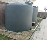 Large tanks store rain water for Waxahachie Dina Rolan's traditional vegetable and fruit gardens. Water is release by a twice twice daily.