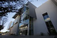 An exterior photo of the back entrance on of the Edith O'Donnell Arts and Technology Building at the University of Texas at Dallas, in Richardson.