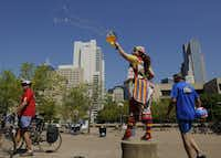 Michelle Feigenbaum, who goes by the clown name of Kook-e entertains riders in the Tour of Dallas travel at the finish on April 2, 2011.The non-competitive ride traveled through neighborhoods and around White Rock Lake.