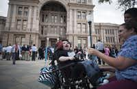 Johnathan Arrambide-Garza, 5, his caregiver, Jennifer Atwater, and his aunt Stevie Sanchez took part in the rallies Tuesday against proposed budget cuts to nursing homes and in-home care.
