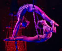 Performers act out the role of 'flying ornaments' during a performance of 'Cirque Dreams Holidaze' at the Winspear Opera House in Dallas, Tuesday, December 18, 2012.