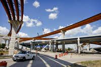 A gargantuan ramp system at State Highway 121 and the Dallas North Tollway is taking shape thanks to the cash infusion from the toll-road deal.