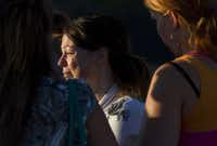 A woman cries outside Gateway High School where witness were brought for questioning after a gunman opened fire at a midnight premiere of The Dark Knight Rises Batman movie Friday, July 20, 2012 in Aurora, Colo.