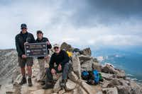 A group of Beaver Creek climbers rest on the summit of Mount Massive, Colorado's second highest peak.  The views from up top may be grand but the feeling of accomplishment is even grander.