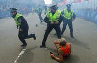 Amid the chaos, the authorities directed runners and onlookers to the area designated for family members awaiting loved ones at the end of the race.John Tlumacki - The Boston Globe