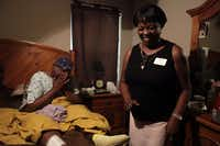 Druscilla Waites (left) was emotional as a meal is delivered to her home by Joyce Gause from Meals on Wheels last week in Dallas.