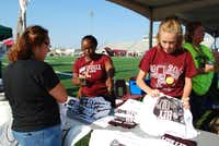 Lewisville High School teacher Shonedra Redd, center, and eighth-grader Avery Bonner, right, visit with parents and students during the district's Hey! Day community event Aug. 16. The high school is just one of a number of schools rebuilt with bond funds.