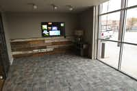 A small meeting room with a flat-panel display is one of the areas for rent at Common Desk in Deep Ellum.