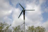 A small wind turbine is used in conjunction with solar panels to power the irrigation system at Eden's Garden in Balch Springs.