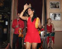 A salsa band plays at Floridita's, a bar where Ernest Hemingway hung out in Havana. The singer is using a giro, Latin-American percussion instrument. The hole in one side lets it convert into an impromptu tip jar, passed around after the show.Joy Tipping  -  Staff
