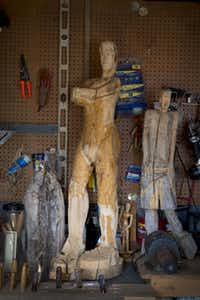 Two works by Duncanville wood carver George Cephus in the shop behind his house on February 6, 2013.