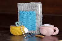 """Items the that Meredith Crawford has crocheted and knitted are coffee cups, a cover for her daily planner and scissors handle covers. Crawford, a freelance writer and blogger of """"www.onesheepishgirl.blogspot.com"""" took up knitting and crocheting in college."""