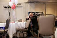 Craig Bass sits in disbelief after the announcement of President Barack Obama's re-election during the Dallas County Republicans' election night event at the Hilton Dallas Lincoln Center.