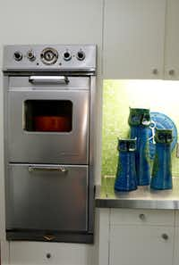 Small by 21st-century standards, the wall oven is original to the house.