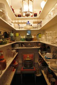 A generous closet stores the household's table settings.