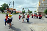 Students from Jack Lowe Sr. Elementary cross the intersection that gives the Five Points area of northeast Dallas its name. The area is one of the city's top crime hot spots.