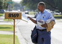 Jonathan O'Hara, a letter carrier for the U.S. Postal Service, delivers mail on his route along Green Hollow Lane in Dallas. The number of letter carriers has dropped across the country from a high in 1989 of 240,000 to around 190,000 in recent years, said Jim Sauber, chief of staff for the National Association of Letter Carriers.Brandon Wade  -  Special Contributor
