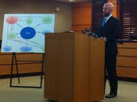 Harry Jones of the Littler Mendelson law firm discusses findings of an investigation into Garland ISD teacher visas at a Tuesday press conference. (Ray Leszcynski/Staff)
