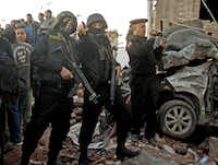 Egyptian security forces gathered at the scene of an explosion at police headquarters in Mansour on Tuesday. The Muslim Brotherhood was blamed for the blast although another group claimed responsibility.