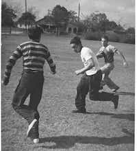 Teenage boys spent a sunny North Texas day playing football at Exline Park in Dallas in 1940.