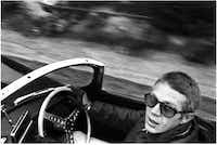 A 1962 William Claxton shot of Steve McQueen in his Jaguar XK-SS