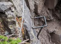 Via Ferrata builders bolted U-shaped rungs to the rock in spots where natural hand or footholds are nonexistent.  Hikers use an array of these to spider across the cliff face known as the Main Event.
