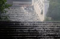 Water rushed down the staircase as Dallas Fire-Rescue crews fought a blaze at the former Church of Scientology Celebrity Centre.