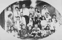 """From """"Former People: The Final Days of the Russian Aristocracy,"""" by Douglas Smith: The golden wedding anniversary of Vladimir and Sofia Golitsyn, Bogoroditsk, spring 1921. Of the 22 pictured here, 13 were to be arrested by the Soviet government, five died or were shot in prison and five left the country."""
