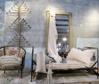 At Carol Hicks Bolton Antiquites in Fredericksburg, you'll find pieces such as this vintage inspired chair created by Carol Hicks Bolton, along with European antiques and linens.