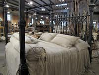 Carol Hicks Bolton Antiquites in Fredericksburg, is known for its antique beds and fine linens.
