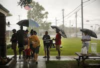 Customers who didn't show up early enough endured squalls of rain while waiting outside Killen's BBQ in Pearland.Tom Fox  -  Staff Photographer