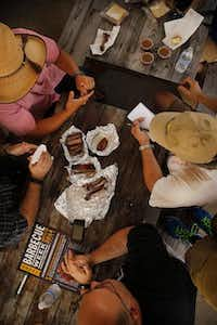 At Brooks' Place in Cypress, the Texas BBQ Posse samples some of the smoked meats.Tom Fox  -  Staff Photographer