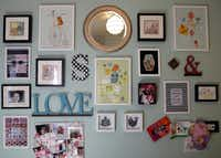 The gallery wall in Sloan's room contains a mix of artwork, letters, a bulletin board and a mirror.
